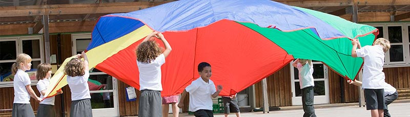 education-kids-playing-with-parachute