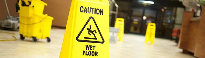 litigation-yellow-wet-floor-sign